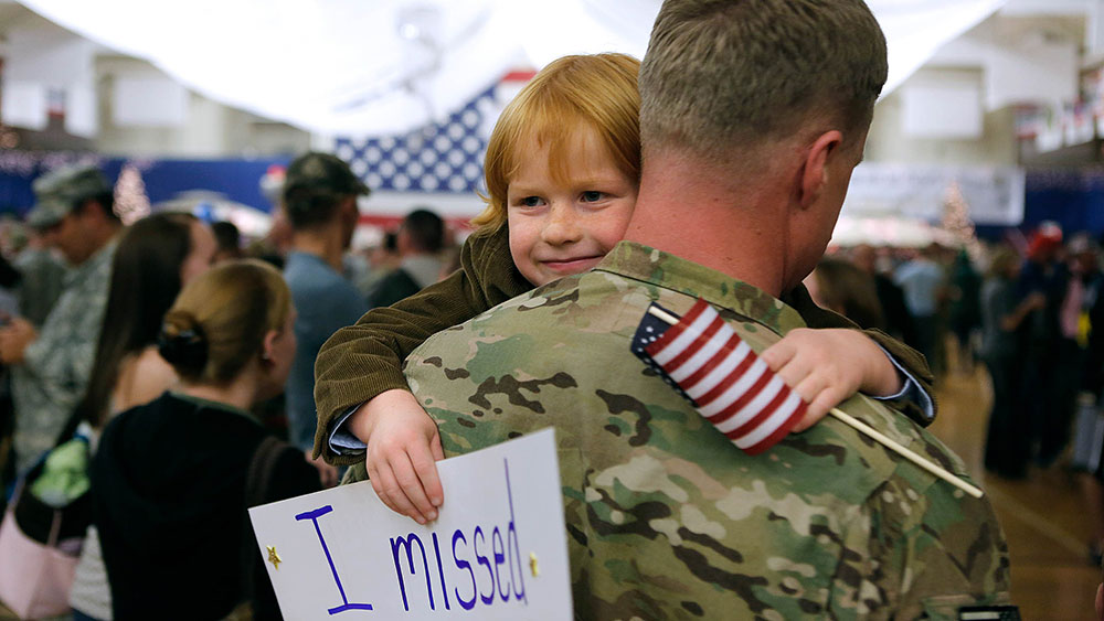 military hugs his daughter